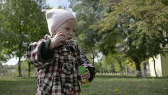 Abstract Little cute Girl Blowing Bubbles in the Park Stock Footage