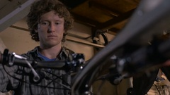 A bike mechanic fixes the front end of a bicycle Stock Footage