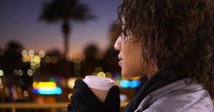 Closeup of black woman drinking cup of coffee, enjoying in the city. Stock Footage