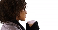Closeup of black woman drinking cup, holding paper cup on white background. Stock Footage