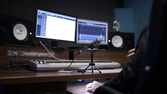 Audio recording professional adjusts large mixing board in recording studio Stock Footage