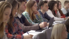 Many smart students during the university presentation in the lecture hall Stock Footage