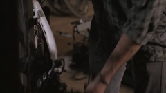 Pan up of a young attractive bike mechanic working on a bicycle Stock Footage