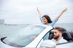 Young beautiful couple on road trip drive in car Kuvituskuvat