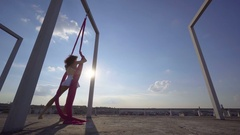 Beautiful dancer on aerial silk. Young sexy woman performs acrobatic stunts on Stock Footage