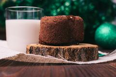 Chocolate cake, a glass of milk and Christmas decorations on wooden table Kuvituskuvat