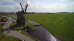 Windmill volendam water management bicycling Stock Footage