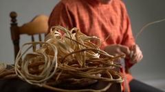 View of craftsman weaves basket in studio Stock Footage