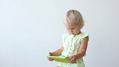 Little Girl Plays on the Tablet PC. Stock Footage