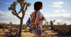 Lovely young female hiker exploring the Mojave Desert, Joshua Tree. Stock Footage