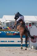 Horse obstacle jumping competition Stock Photos