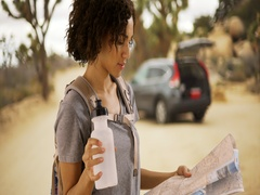 Lost female hiker looking at map of Mojave Desert, Joshua Tree, National Park. Stock Footage