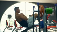 Male bodybuilder doing abs on a bench at the gym slow motion Stock Footage