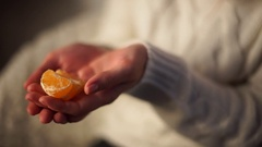 Purified Mandarin at the hands of the girls Stock Footage