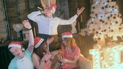 Young men and women taking self photograph at Christmas party. Froozen Stock Footage