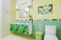 Bathroom design with beautiful grass print on bath cabinet and wc Stock Photos