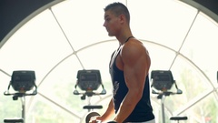 Male bodybuilder training at the gym using barbell Stock Footage