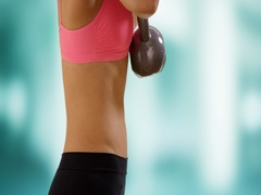 Closeup of young black woman lifting kettlebell weight. Stock Footage