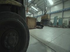 Forklift carrying a metal object in factory Stock Footage