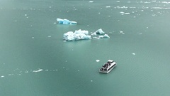 Boat approaching an Iceberg in the Lake Stock Footage
