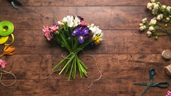 Creation of bouquet from flowers with different colours Wooden background Stop Stock Footage