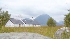 Glencoe Cottage Mountains Scotland Stock Footage