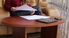 Young businesswoman working with documents. Stock Footage