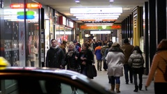 People walking the shopping street with shining frontages in Vienna Austria Stock Footage