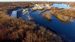 Aerial view of scenic river flowing through industrial region Stock Footage