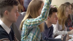 Attentive and smart student raising a hand to ask a question Stock Footage