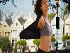 Happy black woman spinning around in front of the painted ladies, San Francisco. Stock Footage