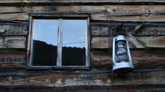 Wooden shed. Window. Kerosene lamp. Russian Siberia. Stock Footage