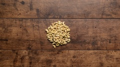 Diffeerent kind of nuts Increasing from one to handful Wooden background Stop Stock Footage