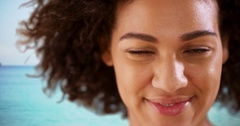 Close-up of Smiling African American woman at the beach..  Headshot of woman Stock Footage