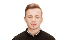 Upset young handsome man listening over white background Stock Footage