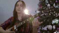 The girl is playing guitar and singing with closed eyes. Stock Footage