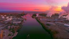 Scenic Fox River industrial zone predawn aerial flyover Stock Footage
