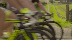 Cycling Slow motion. Cycle race passing through foreground Stock Footage