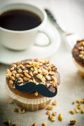 Sweet hazelnut muffin with mustache. Stock Photos