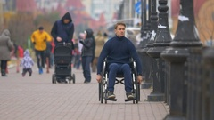 The angry disabled ride the wheelchair. Real time capture Stock Footage