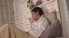 Lady feel bad wearing in white bathrobe Stock Footage