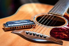 Acoustic guitar with blues harmonica country Stock Photos