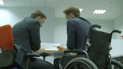 The businessman discuss contract in the office. Real time capture Stock Footage