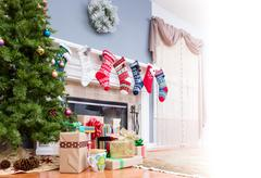 Pile of Christmas gifts under the tree Stock Photos