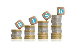 Risk investment concept with coins pillars Stock Photos