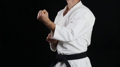A guy with a black belt does professionally blow Stock Footage