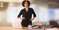 Black businesswoman standing behind office desk looking confident. Stock Footage