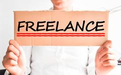 Freelancer concept with businesswoman holding a cardboard Stock Photos