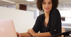 Happy businesswoman smiling at work with laptop computer and tech devices. Stock Footage