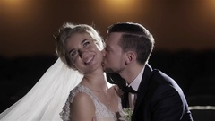Groom seduce bride kiss her neck gallantly close up couple lovers flirt sensual Stock Footage